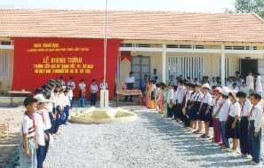 Young guards of honour in front of their newly built school