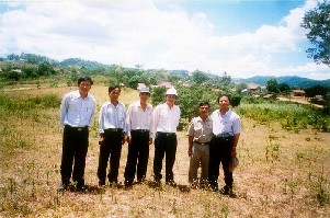Prof N T Tong (right) and local people at the site of the new school