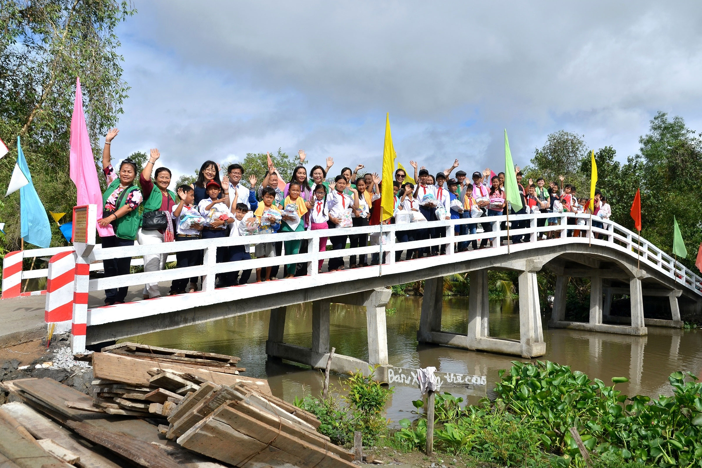 Local children and villagers celebrating the opening of the new Xà Phiên bridge in 2018
